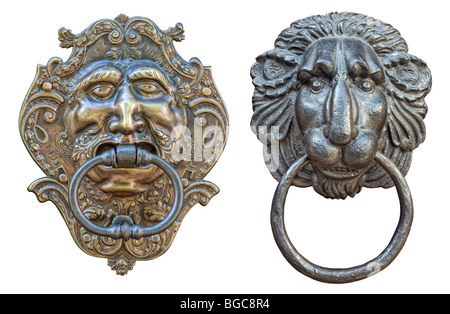 Door knocker, old medieval bronze, in shape of creature head isolated on white background - Stock Photo