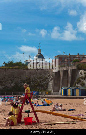 Broadstairs Beach, Kent, England. Lifeguards observing the view on a sunny Summer day. - Stock Photo