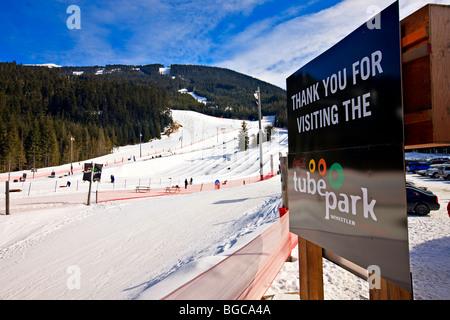 Sign at the Coca-Cola Tube Park on Blackcomb Mountain, Whistler Blackcomb, Whistler, British Columbia, Canada. - Stock Photo