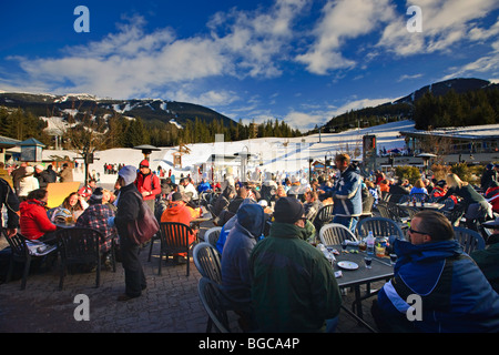 Patrons at the Longhorn Saloon and Grill an apres-ski bar at the base of Whistler Mountain, Whistler Village, British - Stock Photo