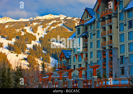 Blackcomb Mountain (2440 metres/8000 feet) and the Pan Pacific Hotel seen from along the Village Stroll, Whistler - Stock Photo