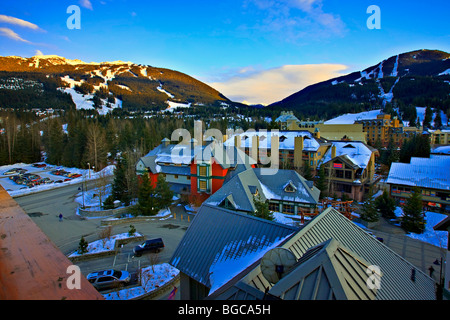 Blackcomb (2440 metres/8000 feet) and Whistler Mountains (2182 metres/7160 feet) seen from the Pan Pacific Hotel - Stock Photo