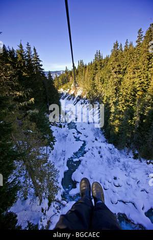 View from the zipline over the Fitzsimmons Creek between Whistler and Blackcomb Mountains, Ziptrek Ecotours, zipline - Stock Photo