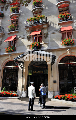 Paris, France- Luxury Hotel , Exterior, Entrance, 'Hotel Plaza Athenée', Front Façade, 'Avenue Montaigne' People, - Stock Photo