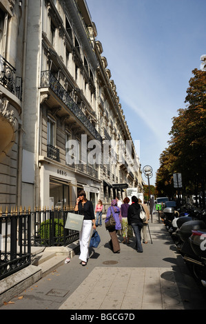 Paris, France, Luxury Clothes Shopping, Woman Walking, Talking on cellphone, Carrying Shopping Bags, 'Avenue Montaigne' - Stock Photo