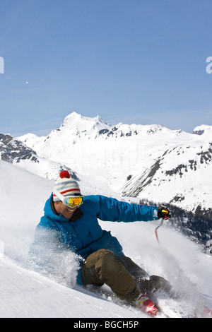 Male skier skid stops on steeps, off-piste Val d'Isere - Stock Photo