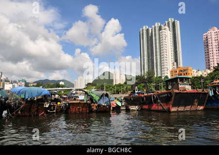 Stern view of houseboat sampans moored on the south side of Aberdeen Harbour, Hong Kong, China - Stock Photo