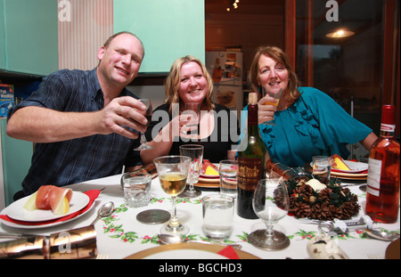 Group of adults having dinner together - Stock Photo