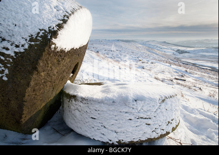 Two Millstones in Winter Snow under ' Stanage Edge' in the 'Peak District', Derbyshire, United Kingdom, Great Britain - Stock Photo