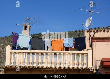 aerials, antenna & washing hanging out to dry on roof of village house,  Relleu, Alicante Province, Comunidad Valenciana, - Stock Photo