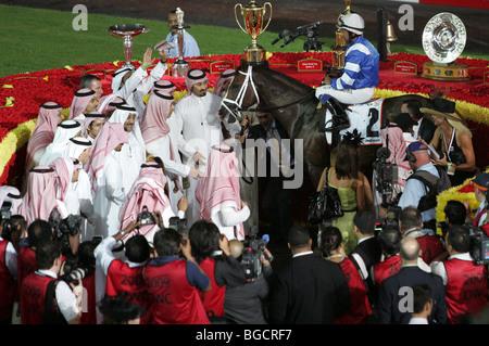 The winner of the race on the Nad al Sheba Racecourse, Dubai, United Arab Emirates - Stock Photo