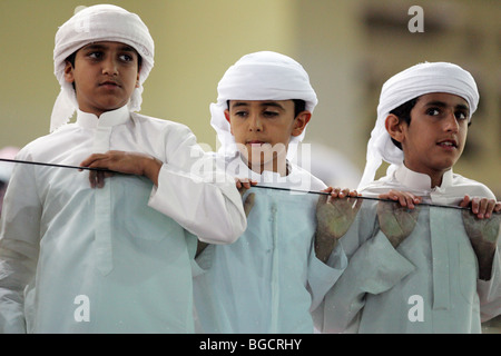 Children in traditional clothing, Dubai, United Arab Emirates - Stock Photo