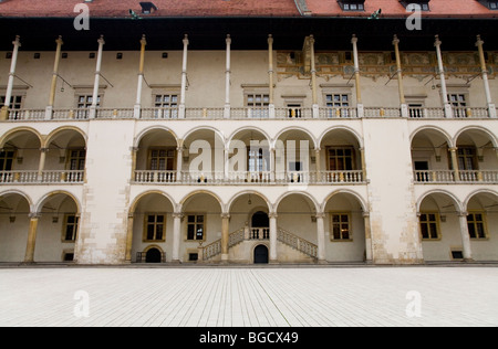The arched cloisters around the 16th Century Renaissance style courtyard. Wawel Castle. Krakow, Poland. - Stock Photo