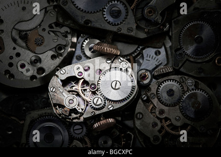 Close-up of antique clockwork. This is an extreme close-up of old clockwork so there is some dust visible. - Stock Photo
