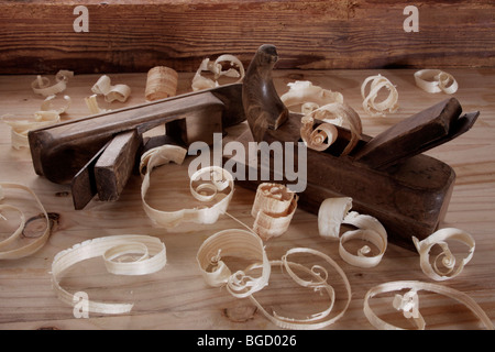 Old plane with wood chips - Stock Photo