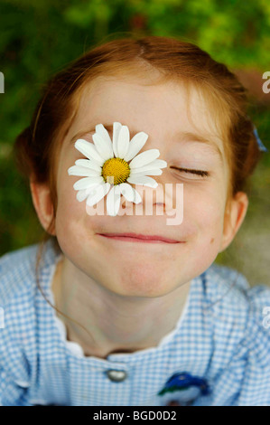 Girl with daisy flower on her face, flower power - Stock Photo