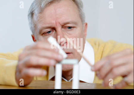 Man, engineer, inventor, architect thinking, playing, inventing, planing, constructing - Stock Photo