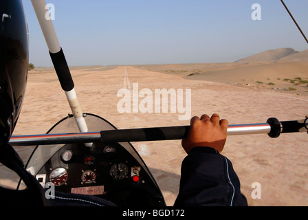 Takeoff for a microlight flight over the Gobi Desert, aerial view of sand dunes in the Gobi Desert, Silk Road, Dunhuang, - Stock Photo