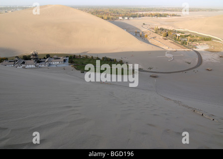 View from the sand dunes of the Gobi Desert on the Crescent Lake with Chinese Pagoda in Dunhuang, Silk Road, Gansu, - Stock Photo