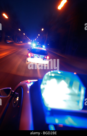 patrol car of the police in operation with blue lights switched on and siren, Germany, Europe. - Stock Photo