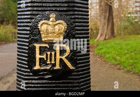 Queen's coat of arms on a royal park lamp post in Regents Park London UK - Stock Photo