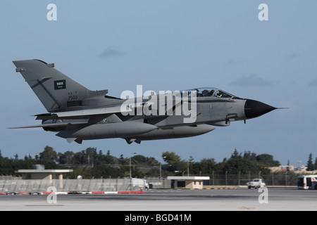 Military aviation. Royal Saudi Air Force Tornado IDS bomber aircraft flying to Saudi Arabia after undergoing refurbishment - Stock Photo