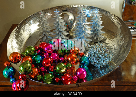 Colorful Christmas balls and small Christmas trees decorated in a silver dish for sale, Villa Ambiente, Im Weller, - Stock Photo