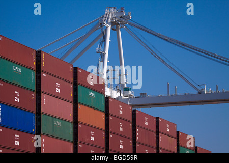 Crane and stacks of portainers on a cargo container ship