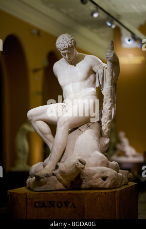 Marble statue of Greek hero Theseus sat astride the dead Minotaur by Antonia Canova in 1782 in the V&A museum in - Stock Photo