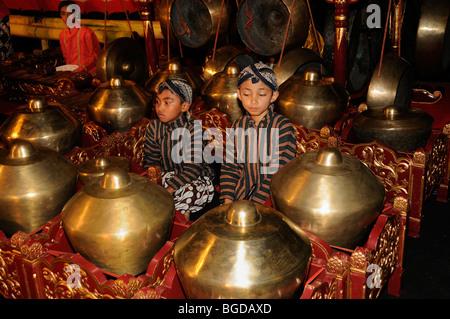 Children playing gamelan music, metallophones in Yogyakarta, Java, Indonesia, Southeast Asia - Stock Photo