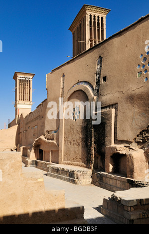 Adobe building with windtower in the historic town of Yazd, UNESCO World Heritage Site, Iran, Persia, Asia - Stock Photo