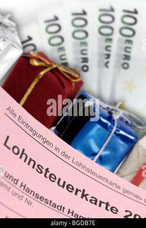 Tax card, gifts and banknotes, symbolic image of tax giveaways - Stock Photo