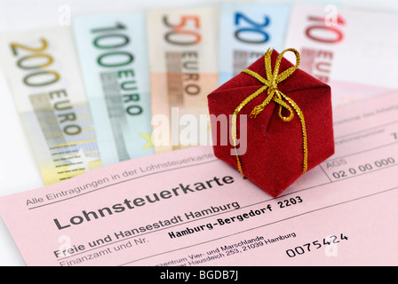 Tax card, gift and banknotes, symbolic image of tax giveaway - Stock Photo