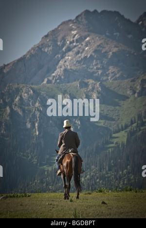 kyrgyz horseman in the mountains around karakol, Kyrgyzstan - Stock Photo