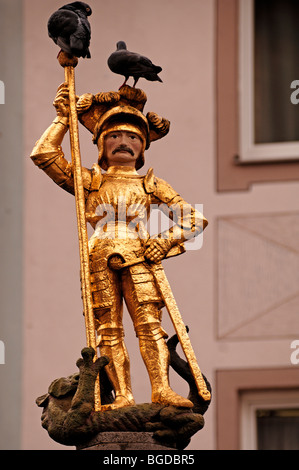 St. George the dragon slayer on a fountain, Herrenstrasse, Freiburg im Breisgau, Baden-Wuerttemberg, Germany, Europe - Stock Photo
