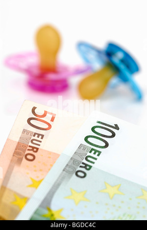 Pacifier and EUR 150 child care cash benefit - Stock Photo