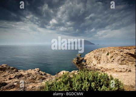 View of Kassos island, south coast of Karpathos island, Aegean Islands, Aegean Sea, Dodecanese, Greece, Europe - Stock Photo