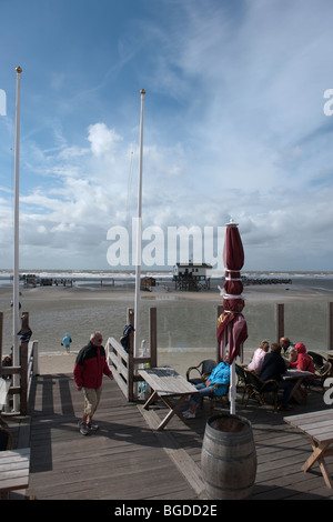 Cafe in a house built on stilts above the flooded beach of St. Peter-Ording, North Sea, North Frisia, North Germany, - Stock Photo