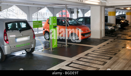 charging station for electrical cars of a rental car company in a public parking garage - Stock Photo