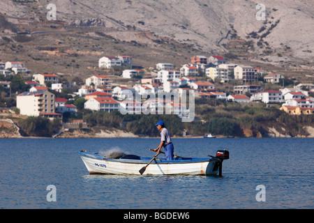 Fisherman in fishing boat off Pag, Pag island, Dalmatia, Adriatic Sea, Croatia, Europe - Stock Photo