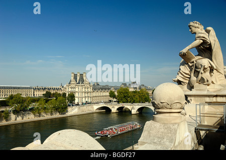 View of the Louvre Museum, Seine River & Bateau Mouche, or Tourist Cruise Boat from the Roof of the Orsay Museum, - Stock Photo