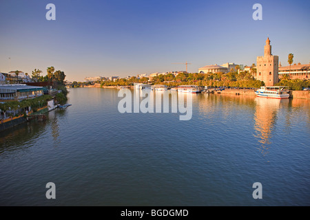 Torre del Oro (Tower of Gold) which also houses the Museo Maritimo (Naval Museum) on the banks of Rio Guadalquivir - Stock Photo