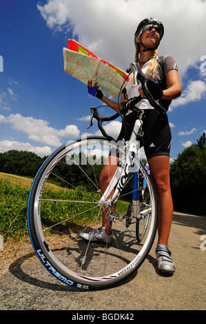 Young woman on a bicycle, Bavaria, Germany, Europe - Stock Photo