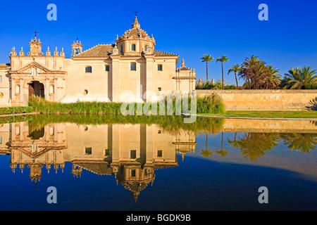 Reflections on a pond in the Jardin de la Cartuja of the Monasterio de Santa Maria de las Cuevas - La Cartuja de - Stock Photo