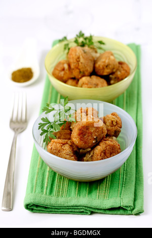 Fish balls with curry. Recipe available. - Stock Photo