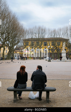 A couple enjoys an early spring time at Piazza Napoleone (Piazza Grande) in Luccca, Tuscany, Italy. - Stock Photo