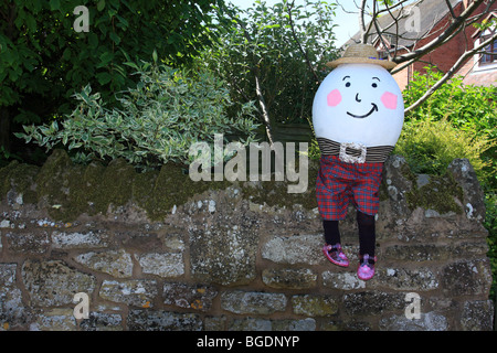 Sitting on his wall awaiting his great fall dear old Humpty Dumpty with a smile on his face. An annual event in - Stock Photo