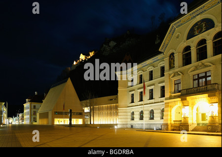 Old and new government building and the princely castle at nightfall - Stock Photo
