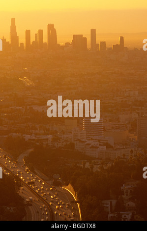Los Angeles skyline sunset view from Mulholland Drive barely visible because of the heavy smog in the air Los Angeles - Stock Photo