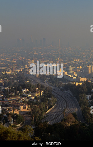 Retro Image 1990's Los Angeles skyline sunset view from Mulholland Drive barely visible because of the heavy smog - Stock Photo
